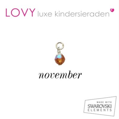 November - okergeel (citrien)